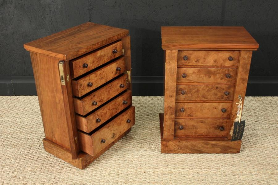 A pair of Antique Wellington Chests of Small Proportions