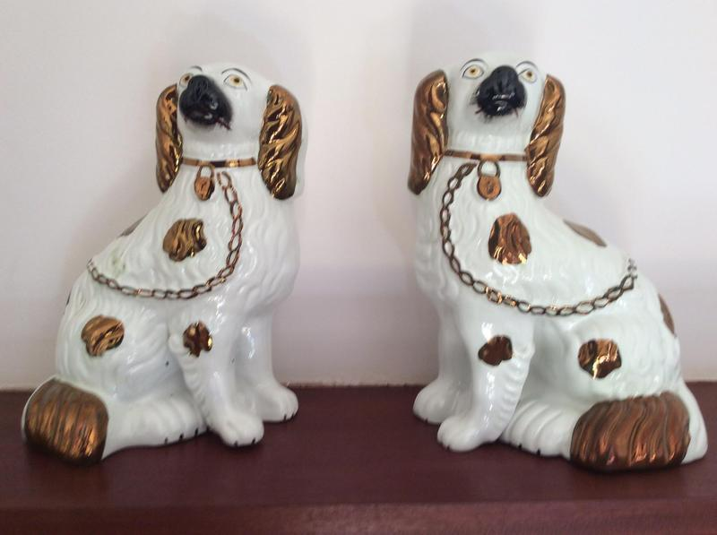 Pair of antique Fireside Staffordshire copper lustre spaniel dogs